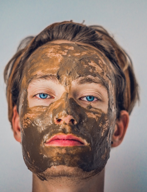Young people experimenting with cosmetics